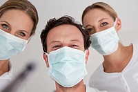 Germany, Dentist with surgical mask, portrait
