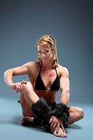 Strong woman relax in amazon fur costume