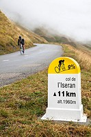 Cycling route sign showing distance and gradient on the road up the Col de L'Iseran, Savoie, France