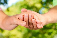 Closeup of senior hands holding together