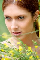 Portrait of beautiful woman in field of flowers
