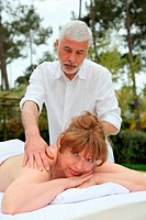 Senior woman having a massage in spa center