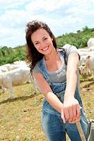 Portrait of breeder standing in farmland