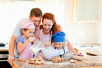 Family having a great time baking together