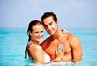 Portrait of happy couple having good time in the water