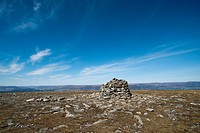 A cairn marking the top of a glen in the Scottish highlands