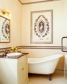 Tiled Bathroom with Claw_foot Bathtub