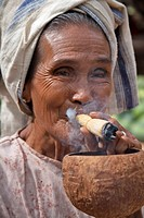 Woman smoking tobacco, Bagan, Myanmar