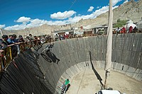 India, Ladakh, Leh, Tibetan circus fair with stunt man going vertical with car and motorcycle