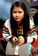 Mizoram a state in Northeast India is home to several tribes each having a unique cultural identity. This modern young girl in traditional clothes is ...