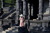 Girl in Ao Dai traditional Vietnamese long dress and conical hat at Tomb of King Khai Dinh, Hue, Vietnam.