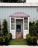 Small Vestibule Against Metal Shed
