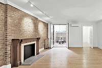 Empty apartment with fireplace and antique mantel
