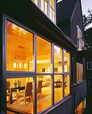 Modern house exterior looking into dining room
