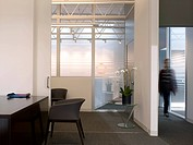 Open plan multi_office space with person. Los Angeles, CA