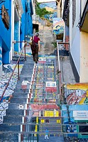 ValparaIso, Chile. South America. Woman tourist on steep painted stairs of Pasaje Santa Lucia. Cerro Bellavista. MR MR