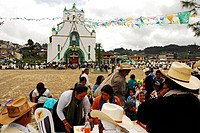 Mexico, San Juan de Chamula, local indigenous people gathering in front of the main square of Chamula´s church, to watch Santa Rosa, the patron saint ...