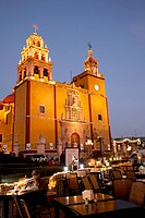 North America, Mexico, Guanajuato State, Guanajuato, Cathedral of Guanajuato, floodlit at dusk, and an outdoor restaurant. The historic city of Guanaj...