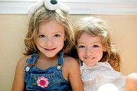 Two little beautiful toddler twin sisters