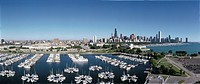 This is an aerial view of the Shedd Aquarium, Chicago Harbor and the skyline on Lake Michigan during summer. Boats are moored in the harbor in the for...