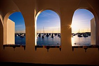 This is the view of Avalon overlooking the Harbor on Via Casino. It shows morning on Catalina Island looking out an arched window.