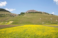 landscape wiyh the village of castelluccio di norcia, umbria, italy, europe