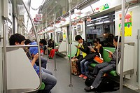 China, Shanghai, Metro, subway, public transportation, riders, Asian, man, woman, Green Line 2