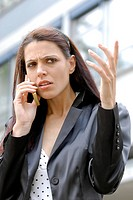 Woman is unsing her mobile phone