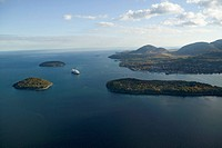 Aerial view of Porcupine Islands, Frenchman Bay and Holland America cruise ship in harbor, Acadia National Park, Maine