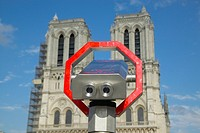Binoculars pointed at Notre Dame Cathedral, Paris, France
