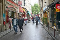 Street with fast food or take out restaurants, Paris, France