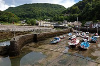 Small boats in Lynmouth Harbour at low tide, Exmoor National Park, North Devon, England, UK, Europe