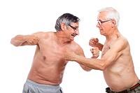 Two naked senior men fighting, isolated on white background