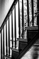 An architectural study of a wooden stairway in black & white