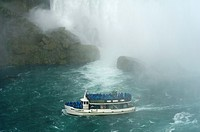 Maid of the Mist boat carrying tourists at the bottom of Niagara Falls