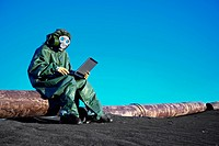 Scientist with a laptop on chemically contaminated area
