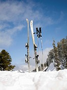 Skis and ski poles in the snow