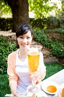 Woman has glass that beer enters