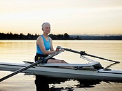 Mature female rower in single scull
