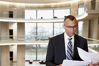 businessman with papers in modern interior