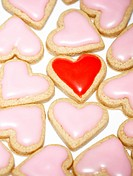 pink heart cookies with one red heart
