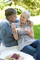 Mature couple having a picnic