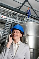 Business woman wearing safety hat