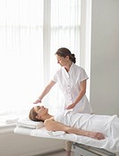 Woman recieving alternative therapies.
