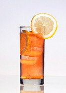 A rock shandy, cool, melting ice, waits, ready for a pair of lips around the straw
