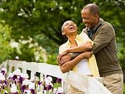 Senior man embracing a senior woman from behind