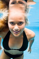 Portrait of a teenage girl swimming underwater