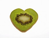 Heart shaped slice of kiwi on white background