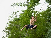 WR0860296 Portrait of a boy swinging on a rope