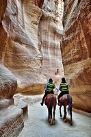 Petra, Jordan  Policemen and horses go through the Siq